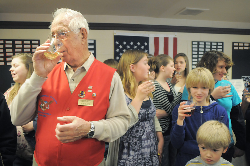 Bob Davis, left, with the Broomfield Veterans Memorial Museum joins in the toast for the new year with Hulstrom Options School students during the open house on Saturday.<br /> January 14, 2012<br /> staff photo/ David R. Jennings