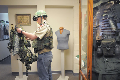 Boy Scout Connor Parker, 15, with Troop 511,  tries on Vietman era gear during the open house at the Broomfield Veterans Memorial Museum on Saturday. January 14, 2012 staff photo/ David R. Jennings