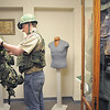 Boy Scout Connor Parker, 15, with Troop 511,  tries on Vietman era gear during the open house at the Broomfield Veterans Memorial Museum on Saturday.<br /> January 14, 2012<br /> staff photo/ David R. Jennings