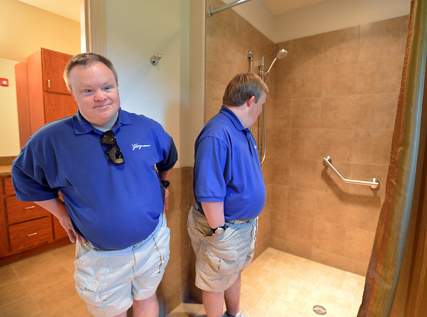 Mike Hembd, left, and his twin brother Mark, right, show off their bathroom with a walk-in shower during a tour, on Saturday, of the the open house of the Glory Community, a private nonprofit, residential home for adults with intellectual disabilities. The Hembd's will be living in the house starting October 1st with six other residents.<br /> September 21, 2012<br /> staff photo/ David R. Jennings
