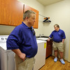 Mark Hembd, left, and his twin brother Mike, 43, check out the laundry room during a tour of their new home the Glory Community, a private nonprofit, residential home for adults with intellectual disabilities. The Hembd's will be living in the house starting October 1st with six other residents.<br /> September 21, 2012<br /> staff photo/ David R. Jennings