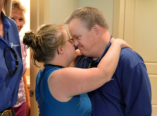 Mark Hembd, right, rubs noses with his girlfriend Meghan Doherty during a tour of Mark and his brother Mike's room at the Glory Community, a private nonprofit, residential home for adults with intellectual disabilities. Hembd will be living in the house starting October 1st with six other residents and his twin brother Mike.<br /> September 21, 2012<br /> staff photo/ David R. Jennings