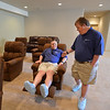 Mark Hembd, left, sits in a chair while checking out the entertainment room with his  twin brother Mike, 43, in their new home, the Glory Community, a private nonprofit, residential home for adults with intellectual disabilities.The Hembd's will be living in the house starting October 1st with six other residents.<br /> September 21, 2012<br /> staff photo/ David R. Jennings