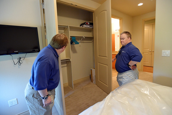 Mike Hembd, left, and his twin brother Mark, right, 43, look at Mike's closet during a tour of their new home the Glory Community, a private nonprofit, residential home for adults with intellectual disabilities.The Hembd's will be living in the house starting October 1st with six other residents.<br /> September 21, 2012<br /> staff photo/ David R. Jennings