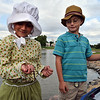 Payton Delier, 7, left,dressed in a Becky Thatcher outfit,  holds a worm as her cousin  Jack Kegerreis, 7, watches during the Optimists Club Fishing Derby on Saturday at the Trails Park.<br /> August 25, 2012<br /> staff photo/ David R. Jennings