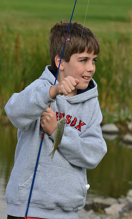 Andrew Saunders, 10, poses for a picture with the fish he just caught during the Optimists Club Fishing Derby on Saturday at the Trails Park.<br /> August 25, 2012<br /> staff photo/ David R. Jennings