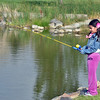 Lujane Yacoub, 7, fishes from the shore during the Optimists Club Fishing Derby on Saturday at the Trails Park.<br /> August 25, 2012<br /> staff photo/ David R. Jennings