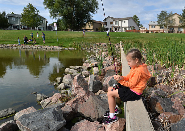 Gracie Scruggs, 7, fishes from a small dam during the Optimists Club Fishing Derby on Saturday at the Trails Park.<br /> August 25, 2012<br /> staff photo/ David R. Jennings