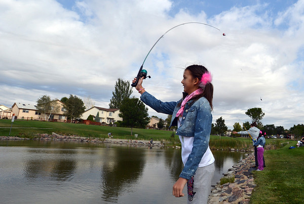 Emiko Boyer, 11, casts her line during the Optimists Club Fishing Derby on Saturday at the Trails Park.<br /> August 25, 2012<br /> staff photo/ David R. Jennings