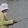Payton Delier, 7, dressed as Becky Thatcher for the Optimists Club Fishing Derby on Saturday at the Trails Park.<br /> August 25, 2012<br /> staff photo/ David R. Jennings