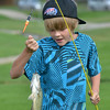 Joel Kressin, 11, holds a fish he caught during the Optimists Club Fishing Derby on Saturday at the Trails Park.<br /> August 25, 2012<br /> staff photo/ David R. Jennings