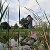 Andrew Saunders, 12, fishes from the rocks during the Optimists Club Fishing Derby on Saturday at the Trails Park.<br /> August 25, 2012<br /> staff photo/ David R. Jennings