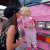 Brittany Orton, left, kisses her daughter Tessa Faye, 2, after posing on a Pink Fire Truck during the Pink Heals Tour stop at the Village at FlatIron Crossing.<br /> Sept. 15, 2009<br /> Staff photo/David R. Jennings