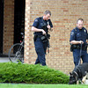 Broomfield police officers and a K-9 unit begin searching for the suspect in the robbery of the Wells Fargo Bank at 2 Garden Center .<br /> <br /> June 10, 2009<br /> staff photo/David Jennings
