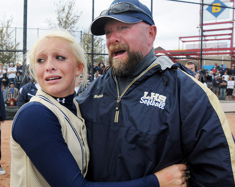 Legacy's Kaitlyn Mattila and her father Kevin were brought to tears of joy after Legacy won their third state 5A softball championship against Ralston Valley at the Aurora Sports Park. Kaitlyn, a seinor, scored the one and only run to win the game.<br /> October 24, 2009<br /> Staff photo/David R. Jennings