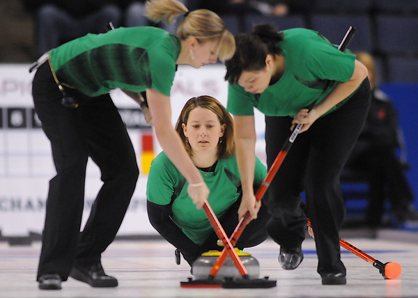 Debbie McCormick, center, skip for her team, watches the stone after a delivery while Nicole Joraanstad, left, and Natalie Nicholson sweep during the championship final against Team Lank at the U.S. Curling Trials at the Broomfield Event Center. <br /> February 28, 2009<br />  staff photo/David R. Jennings