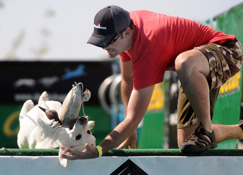 Mike Dameron plays with his dog, Quinn, before jumping in the Dock Dogs contest during Broomfield Days.<br /> <br /> Sept. 19, 2009<br /> Staff photo/David R. Jennings