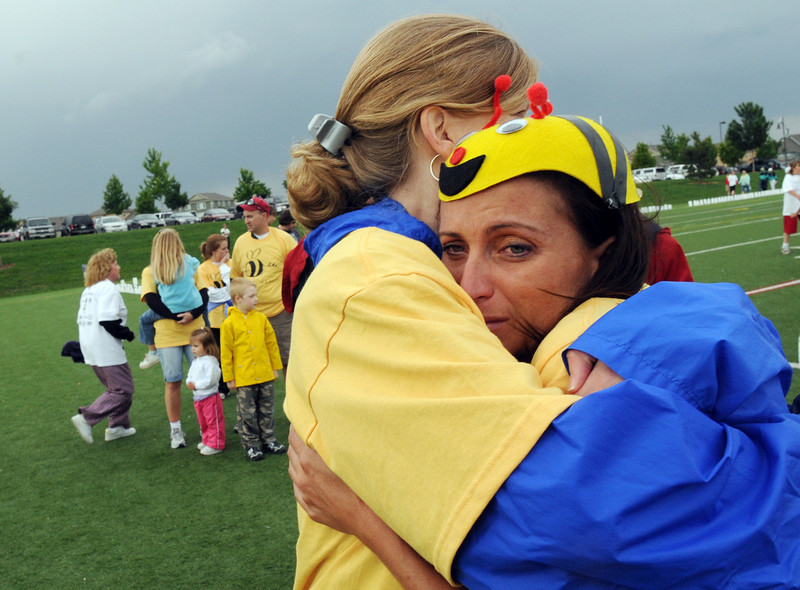 Cancer survivor Brandi Van Degriff, right, is comforted by Jody McCain at the finish of the survivors lap at the 9th annual Relay for Life Broomfield fundraiser for the American Cancer Society at the Broomfield County Commons. <br /> June 12, 2009<br /> staff photo/David Jennings