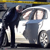 Criminalists look at the suspects vehicle at the scene of a shoot out with Westminster Police at eastbound 120th Ave. and Federal Blvd. Two Westminster officers were shot in the gun battle. <br /> November 19, 2009<br /> Staff photo/David R. Jennings