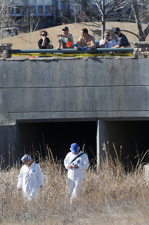 Broomfield police investigators and criminalists search the area where a female body was found in the Boulders at the Broadlands, January 21, 2009. The body was later identified as 13 year-old Kelsey Shannon.<br /> <br /> Enterprise staff photo/David R. Jennings