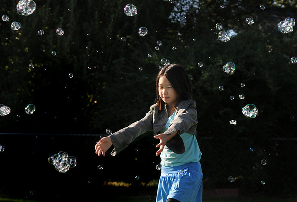 Daenna Xiong, 9, tries to catch bubbles during Broomfield Days.<br /> <br /> Sept. 19, 2009<br /> Staff photo/David R. Jennings