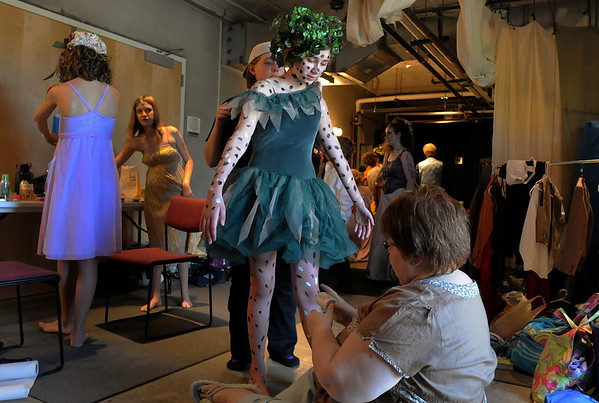 Kayle Lingo, 12, center, stands still while the makeup crew puts dots on her for her part as a fairy in the Summer Youth Players  performance of A Midsummer Night's Dream at the Audi.<br /> August 1, 2009<br /> staff photo/David Jennings