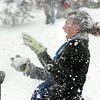 Skyler, Ellis, 15, the organizer of the fight, is pelted by snow balls during the snowball fight organized by Broomfield High School students at the Broomfield County Commons.<br /> <br /> October 29, 2009<br /> Staff photo/David R. Jennings