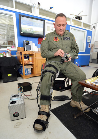 Stewart McQuillan with TYJ Global,  on Thursday, demonstrates his invention the Heli Leg, a device powered by compressed air, allowing a paraplegic pilot to fly  a helicopter, at TYJ Global at Rocky Mountain Metropolitan Airport. <br /> November 1, 2012<br /> staff photo/ David R. Jennings