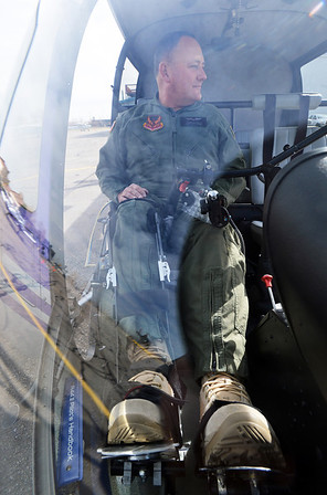 Stewart McQuillan with TYJ Global,  demonstrates the Heli Leg, attached to his right leg, at TYJ Global at Rocky Mountain Metropolitan Airport on Thursday.  McQuillan a  paraplegic pilot, engineer and a military veteran developed the device which allows a paraplegic pilot to fly a helicopter.<br /> November 1, 2012<br /> staff photo/ David R. Jennings
