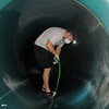 Lifeguard Shane Mortensen brings a water hose through the tunnel of a slide during the deep cleaning of the Paul Derda Recreation Center  on Wednesday.<br /> <br /> August 24, 2011<br /> staff photo/ David R. Jennings