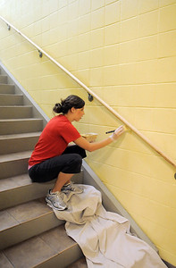 Jen Chrisman, Senior Services Coordinator, paints a wall during the deep cleaning of the Paul Derda Recreation Center  on Thursday.  August 24, 2011 staff photo/ David R. Jennings