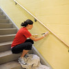 Jen Chrisman, Senior Services Coordinator, paints a wall during the deep cleaning of the Paul Derda Recreation Center  on Thursday.<br /> <br /> August 24, 2011<br /> staff photo/ David R. Jennings