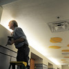 Ken Thomas checks his paint job of the ceiling in the hallway leading to the pool during the deep cleaning of the Paul Derda Recreation Center  on Wednesday.<br /> <br /> August 24, 2011<br /> staff photo/ David R. Jennings