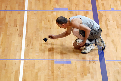 Mike Speak with All City Flooring touches up the basketball floor at the Paul Derda Recreation Center during the deep  cleaning of the center on Thursday.  August 24, 2011 staff photo/ David R. Jennings
