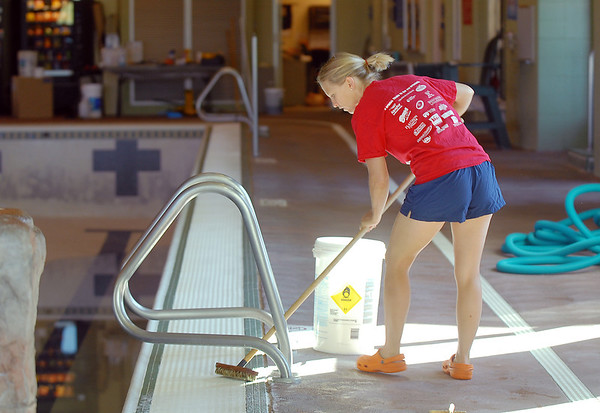 Dawn Rachjaibun scrubs the edges of the pool during the deep cleaning of the Paul Derda Recreation Center on Thursday.<br /> <br /> August 24, 2011<br /> staff photo/ David R. Jennings