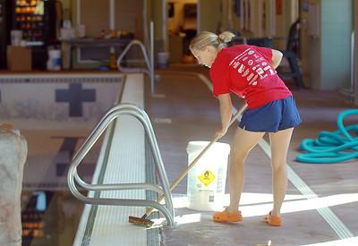 Dawn Rachjaibun scrubs the edges of the pool during the deep cleaning of the Paul Derda Recreation Center on Thursday.  August 24, 2011 staff photo/ David R. Jennings