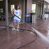 Crystal White power washes the outside deck of the pool during the deep cleaning of the Paul Derda Recreation Center on Thursday.<br /> <br /> August 24, 2011<br /> staff photo/ David R. Jennings