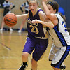 Holy Family's Megan McGillin dribbles the ball downcourt against Peak to Peak's Stephanie Colgate during Friday's girls game at Peak to Peak.<br /> January 25, 2013<br /> staff photo/ David R. Jennings