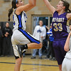 Peak to Peak's Ivy DeVries goes to the basket against Holy FAmily's Claudia Pena during Friday's girls game at Peak to Peak.<br /> January 25, 2013<br /> staff photo/ David R. Jennings