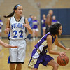 Holy Family's Lindsey Chavez dribbles the ball past Peak to Peak'sBrianna Wetmore and Ivy DeVries during Friday's girls game at Peak to Peak.<br /> January 25, 2013<br /> staff photo/ David R. Jennings