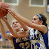 Peak to Peak's Ivy DeVries  and Holy Family's Micaela Blanchard go for the rebound d<br /> January 25, 2013<br /> staff photo/ David R. Jennings