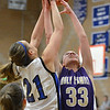 Holy Family's Claudia Pena goes for the rebound  against Peak to Peak's Annette Warner during Friday's girls game at Peak to Peak.<br /> January 25, 2013<br /> staff photo/ David R. Jennings