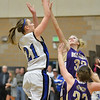 Peak to Peak's Annette Warner shoots the ball against Holy Family's Micaela Blanchard during Friday's girls game at Peak to Peak.<br /> January 25, 2013<br /> staff photo/ David R. Jennings