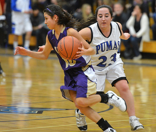 Holy Family's Katie Chavez dribbles the ball downcourt  against Peak to Peak's Stephanie Colgate during Friday's girls game at Peak to Peak.<br /> January 25, 2013<br /> staff photo/ David R. Jennings
