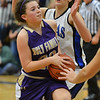 Holy Family's Olivia Quinn goes to the basket  against Peak to Peak's Annette Warner during Friday's girls game at Peak to Peak.<br /> January 25, 2013<br /> staff photo/ David R. Jennings