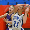 Peak to Peak's Annette Warner, right, goes for the rebound against Holy Family's Micaela Blanchard during Friday's girls game at Peak to Peak.<br /> January 25, 2013<br /> staff photo/ David R. Jennings