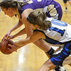 Holy Family's Claudia Pena fights for the ball against Peak to Peak's Katherine Kia during Friday's girls game at Peak to Peak.<br /> January 25, 2013<br /> staff photo/ David R. Jennings