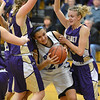 Peak to Peak's Ivy DeVries is sandwiched between Holy FAmily's Maggie Spitzer, left, and Micaela Blanchard during Friday's girls game at Peak to Peak.<br /> January 25, 2013<br /> staff photo/ David R. Jennings