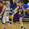 Holy Family's Katie Chavez dribbles downcourt  against Peak to Peak's Brianna Wetmore during Friday's girls game at Peak to Peak.<br /> January 25, 2013<br /> staff photo/ David R. Jennings