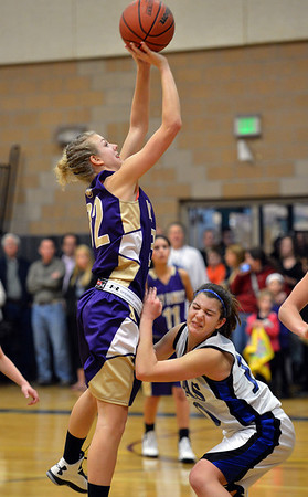 Holy Family's Micaela Blanchard shoots the ball over Peak to Peak's Katharine Kia during Friday's girls game at Peak to Peak.<br /> January 25, 2013<br /> staff photo/ David R. Jennings